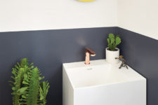 08 The powder room features color blocking, potted cacti and a floating sink with storage