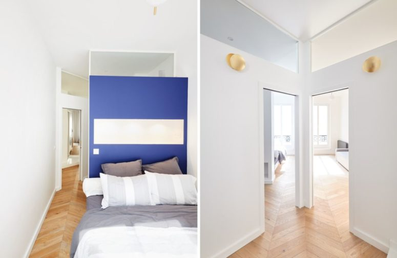 This is another bedroom, with a blue accent wall and a bed - it's light-filled like most of other spaces