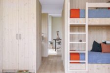 09 The guest bedroom is again clad with the same light-colored wood, there's a bunk bed and some bright touches