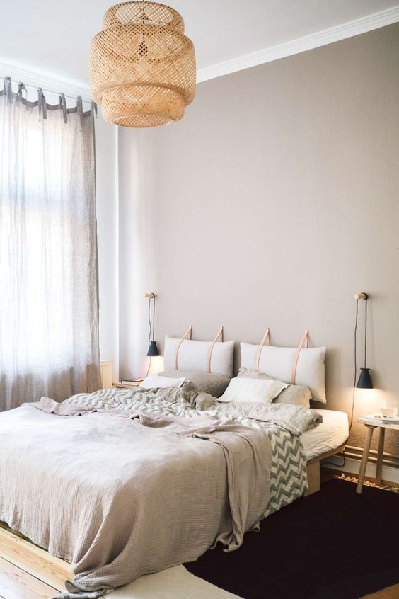 a contemporary bedroom with a hanging pillow headboard that softens and makes the space more welcoming