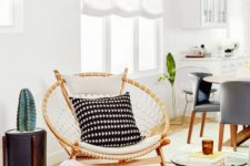 09 a papasan chair styled in a boho way, with macrame and monochromatic pillows for a boho space