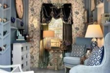 09 a refined she shed done in blues, with a gorgeous chandelier, a velvet curtain and some elegant accessories