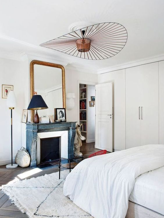 a romantic Parisian bedroom with a statement copper chandelier of a geometric shape is wow