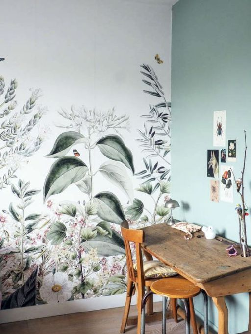 a chic working space or crafting nook with a botanical wallpaper wall and a matching light green one