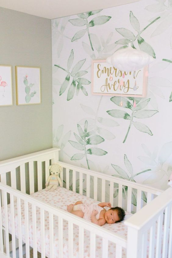 a delicate watercolor leaf print accent wall is a chic and soft idea for a serene and airy space like this one