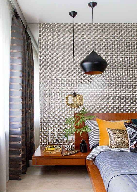 a mid-century modern bedroom with a duo of statement pendant lamps - in black and in amber glass