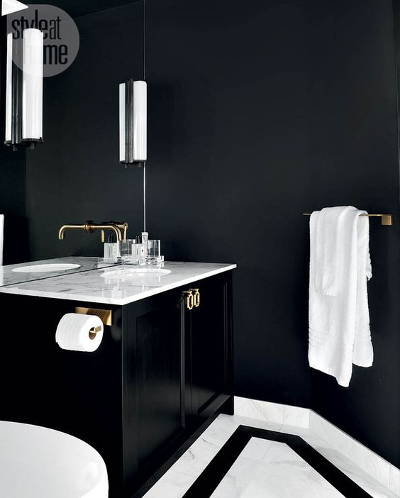 a tiny powder room with onyx walls, white stone for a contrast and a floating black vanity for a shiny touch
