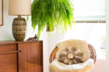 12 a woven papasan chair with a faux fur rug and a pillow paired with a faux leather ottoman for a boho space