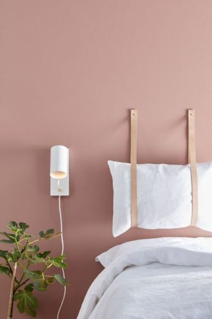 white pillows hanging on wide leather cords look fresh and make the space very soft and tender