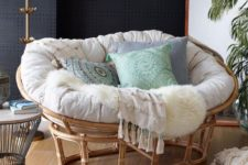 16 a gorgeous rattan mamasan chair with a neutral futon and pastel and printed pillows for a neutral boho space