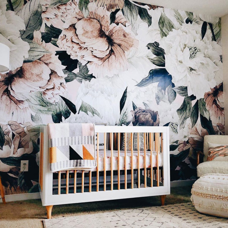 a boho nursery spruced up with a statement realistic floral print wall looks wow