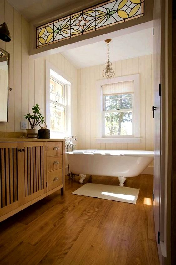 a farmhouse bathroom with a white vintage clawfoot tub that sets the tone in the space