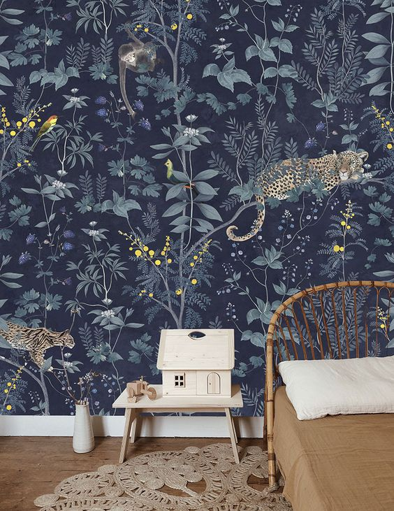 whimsical dark floral and fauna wallpaper for a jungle or tropical-themed nursery or kids' bedroom
