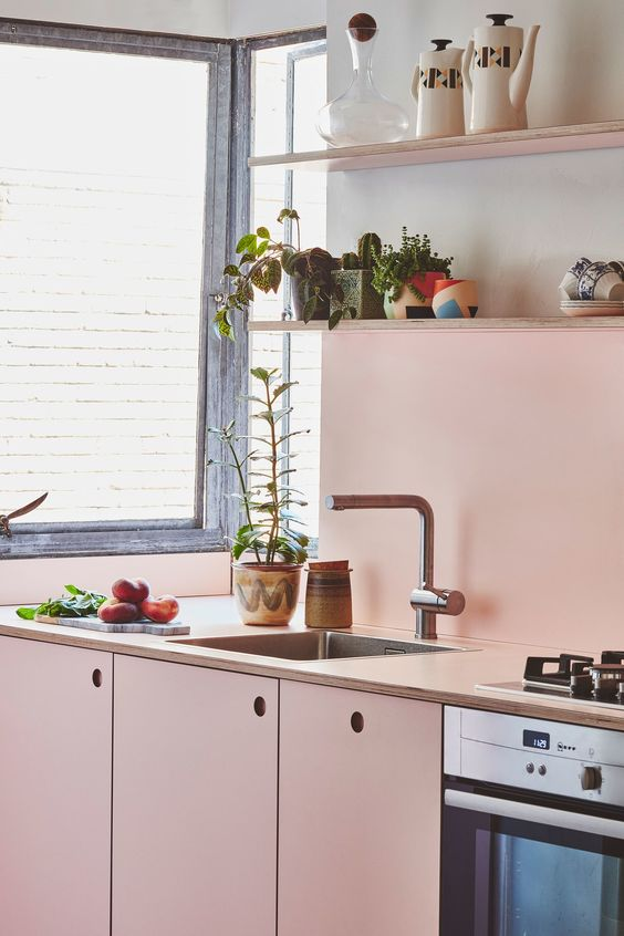 a soft shade of pink adds warmth and coziness to this small kitchen, neutrals make the space bolder