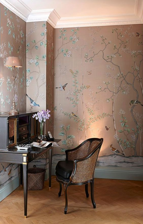 a very refined moody space with floral and fauna wallpaper, elegant vintage furniture and some lights