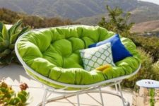 20 a white mamasan chair with a green futon and bright pillows is an amazing item for a modern outdoor space