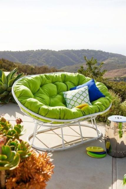 a white mamasan chair with a green futon and bright pillows is an amazing item for a modern outdoor space
