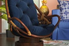 21 a dark swivel papasan rocker chair with navy upholstery is a cool idea that combines two different chairs in one