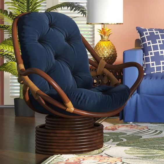a dark swivel papasan rocker chair with navy upholstery is a cool idea that combines two different chairs in one