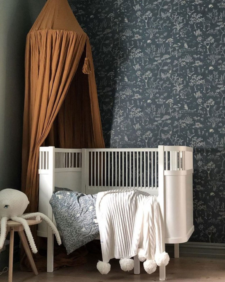 dark botanical print wallpaper is another cool idea to rock dark shades in the nursery
