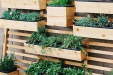 22 a planter wall with wooden fixtures and beams attached to one single wood slab screen is a creative idea