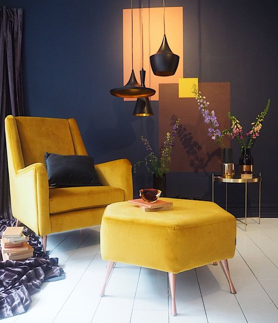 a small contrasting space done in navy and white and made bolder with yellow furniture for a bright look