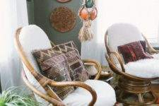 23 a duo of wooden papasan swivel rockers with white futons and boho and folksy pillows