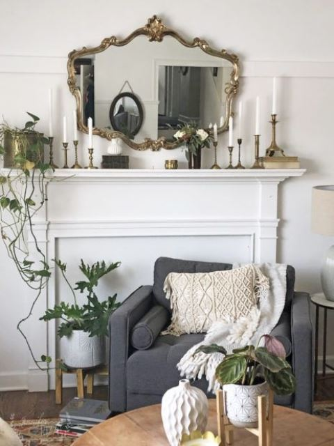 a vintage mirror and matching candleholders raise the living room decor to a new level easily