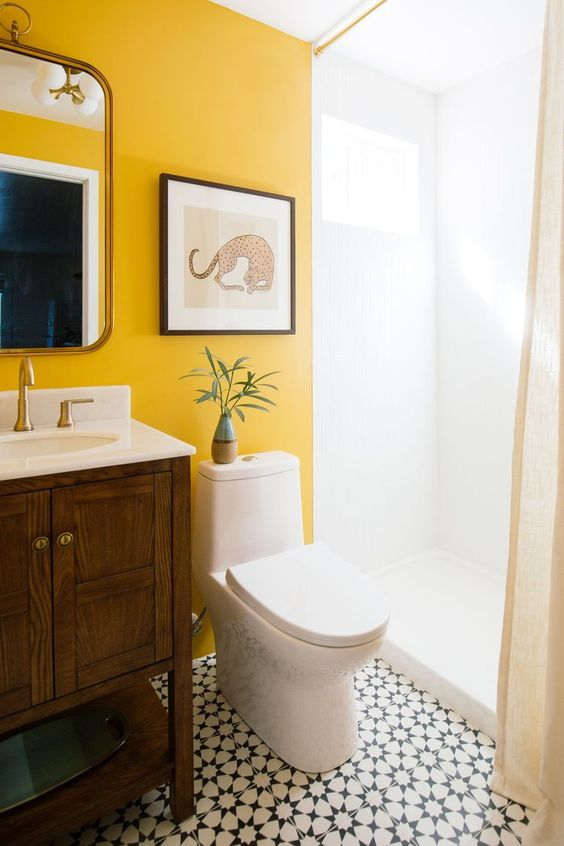 make your monochromatic bathroom unique and bold with a statement marigold wall