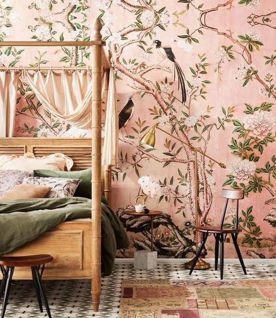 pink flora and fauna wallpaper creates a warm ambience in the bedroom and takes over the whole space