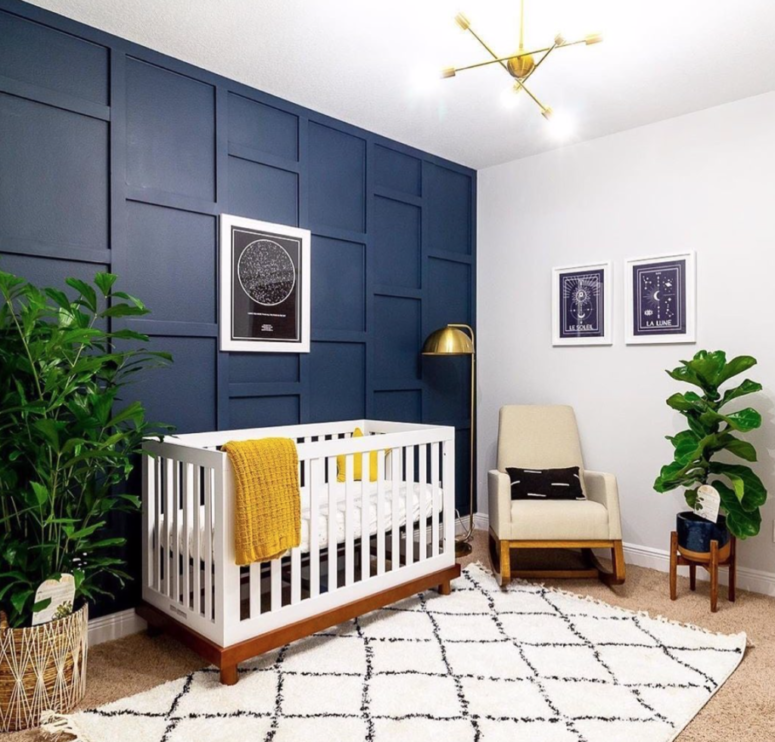 a chic nursery with a navy 3D wall and a navy planter to spice up the neutral space and makes it cooler