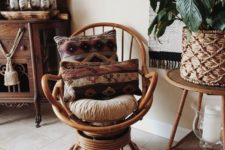 24 a rattan swivel rocker chair with boho pillows and rugs is a cool idea to finish off a boho space