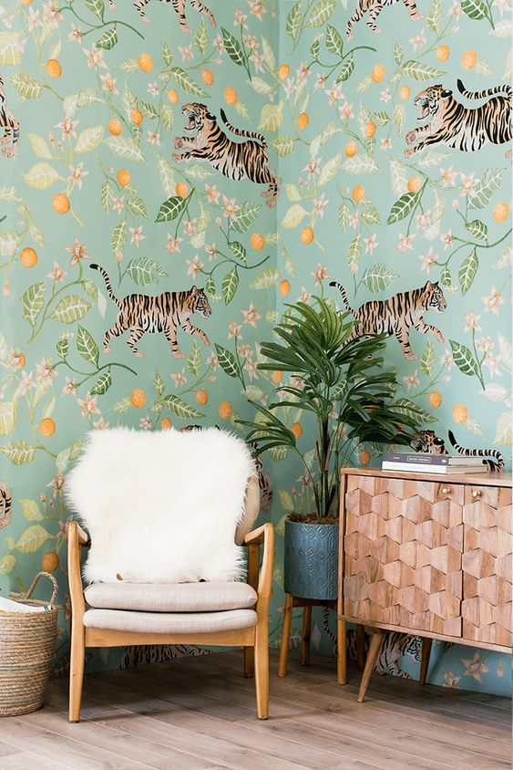 a whimsical space with unique floral and fauna wallpaper that gives a bold tropical feel to the space