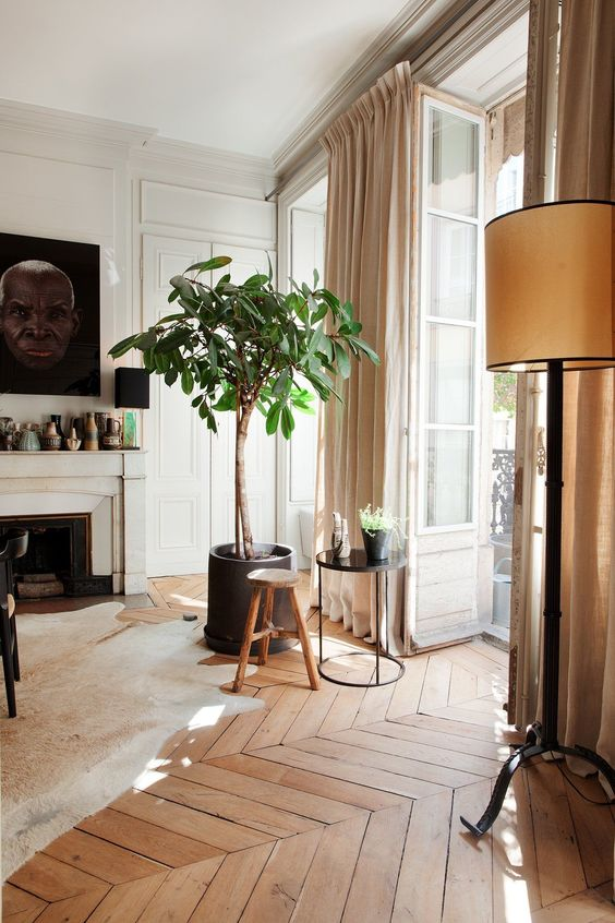 an elegant contemporary interior with a vintage floor lamp that adds coziness and a vintage touch
