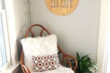 26 a boho nook with a wooden papasan swivel rocker with faux fur and a bright pillow