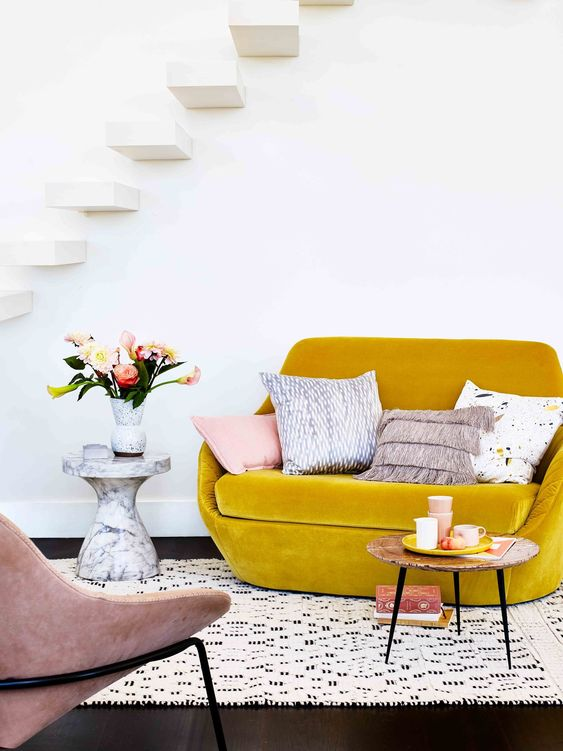 finish off your small living room with a mustard velvet loveseat to add color and texture to the space
