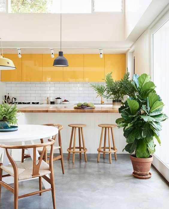 a bright tropical kitchen done with yellow upper cabinets and all white everything plus a skylight for a refresh