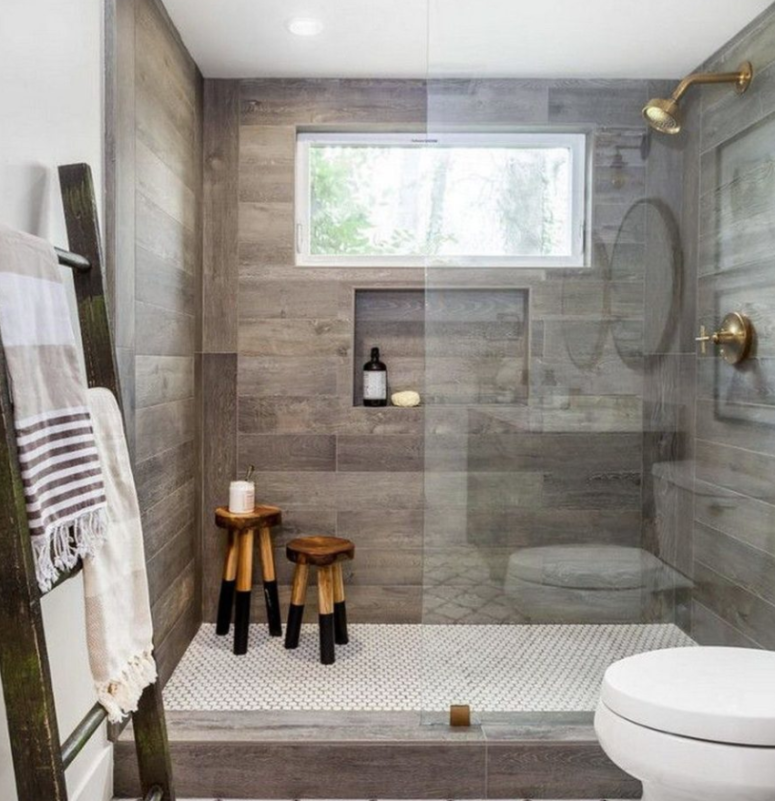 a contemporary bathroom done with mosaic and wood look tiles in the shower to highlight this zone
