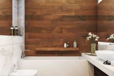 a contemporary bathroom with warm colored wood look tiles and white appliances for a fresh and bold look