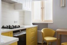 a contemporary kitchen done with white and yellow cabinets with a texture, with white countertops and yellow chairs