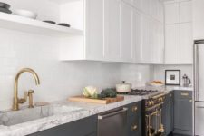 a contemporary kitchen with lower grey cabinets, white upper ones, gold and brass touches, white countertops