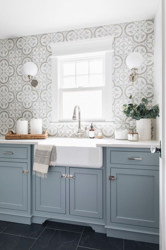 a light blue kitchen with a grey mosaic tile backsplash and metallic handles is a beautiful idea with a traditional feel