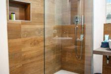 a stylish minimalist bathroom with awesome wood tiles