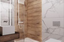 a minimalist bathroom with white marble tiles and wood look tiles in the shower space for a warm touch