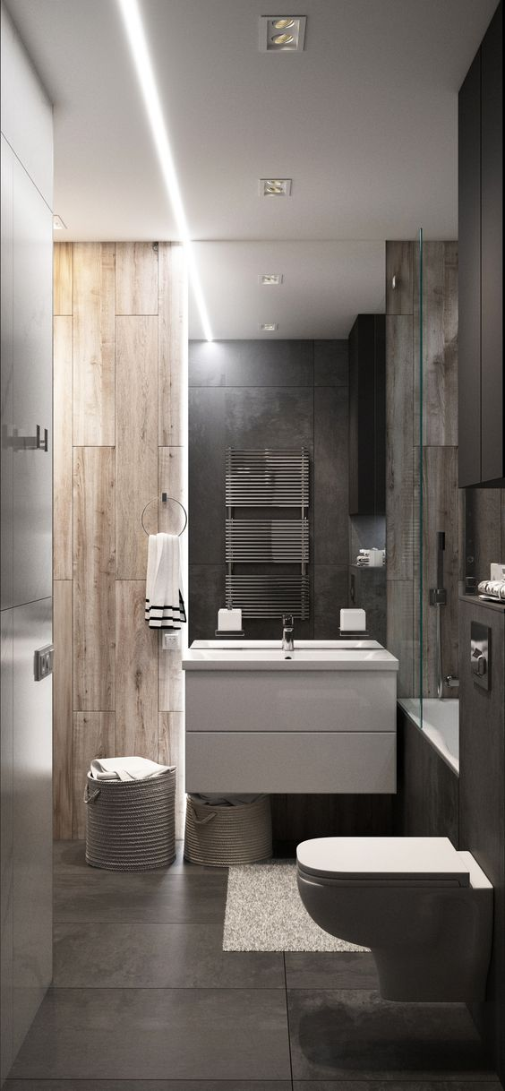 a minimalist bathroom with wood look tiles of two different shades and stone like tiles on the floor