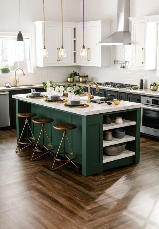 a stylish dark green and white kitchen with brass touches and dark stools plus marble countertops for a bold look