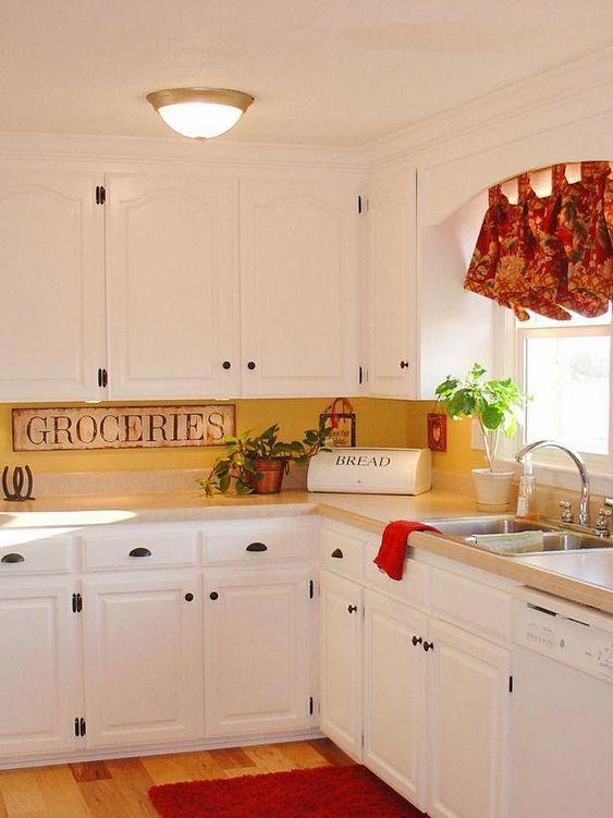 a vintage kitchen in white, a yellow kitchen backsplash and vintage touches plus bright shades for a bolder look