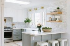 an ethereal kitchen with dove grey lower cabinets, white upper ones, white countertops and tile walls plus touches of gold