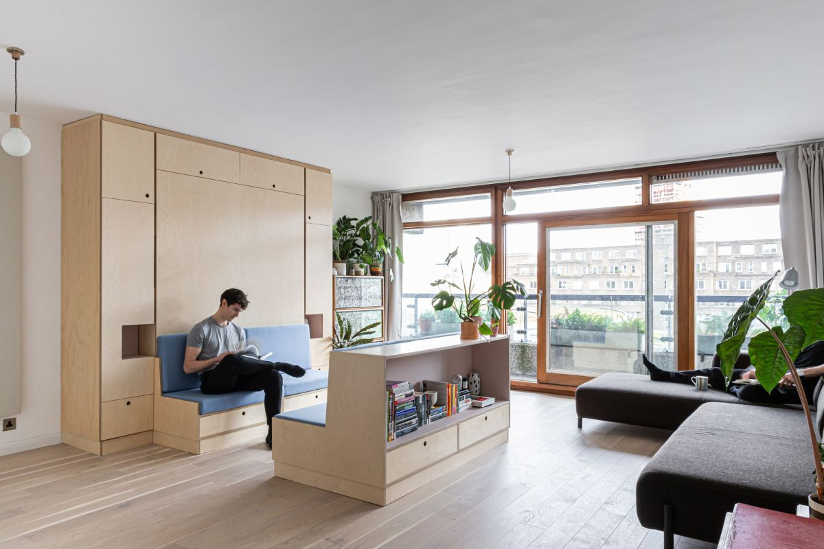 This small apartment is a nice example of how multi functional furniture can completely change the space