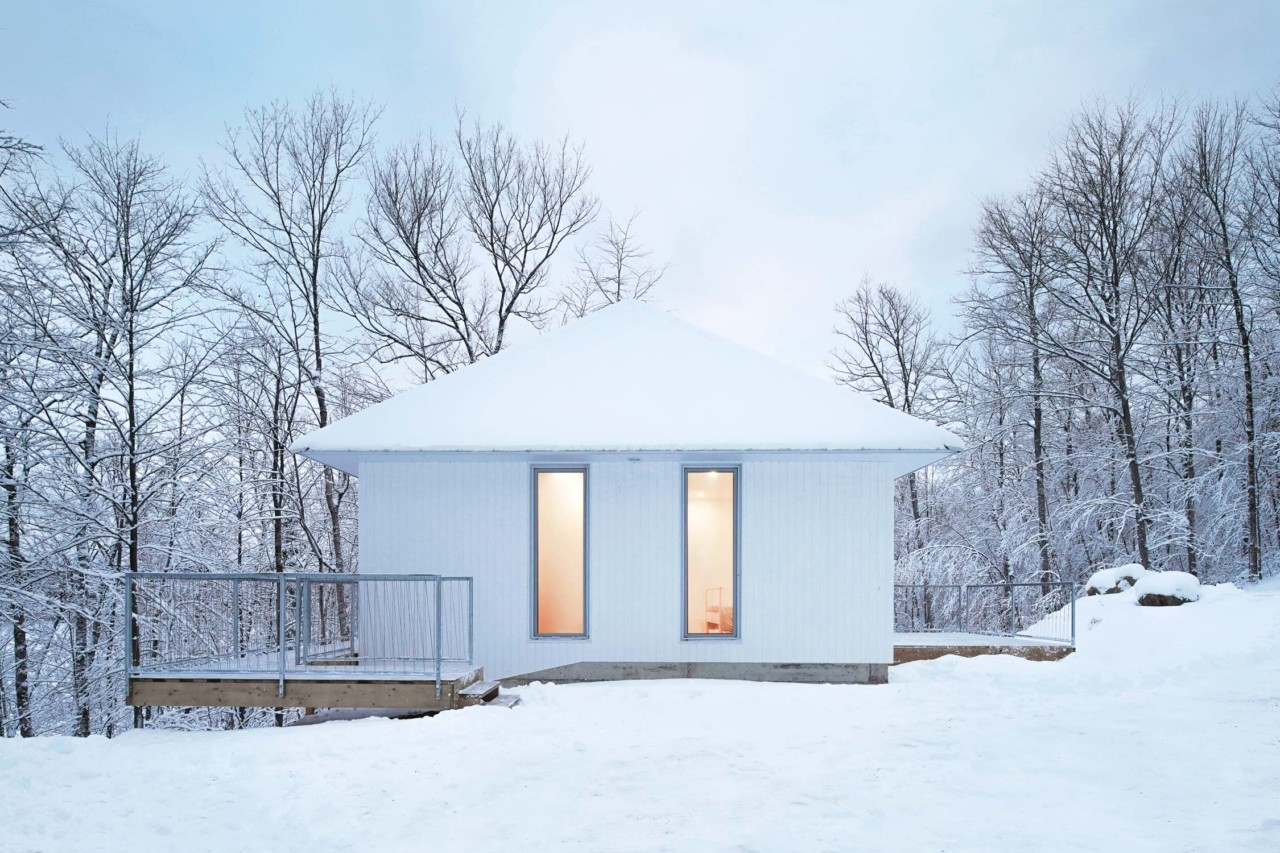 This ultra minimalist white chalet is called Poisson Blanc and is located in Canada
